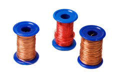 Copper wire reels. Three reels with copper wire isolated on white background Stock Photos