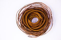 Copper wire. A still life of rings of copper wire of different sizes and shapes stacked in a figure similar to a bird`s nest Royalty Free Stock Photo