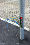 Copper wire thieves. Copper wires in street light pole, small plate missing. By pulling up three or four copper wires that connect one light pole to the next Stock Photo