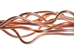Copper wire wave. Isolated on white Royalty Free Stock Image