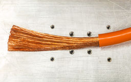 Copper wire on white matal plate Royalty Free Stock Photo