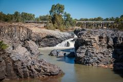 Copperfield Gorge. Water cascades down the falls at Copperfield Gorge. Rail bridge and road bridge in background Royalty Free Stock Image