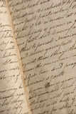 Copperplate handwriting in antique notebook Stock Photography