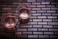 Coppery tea cups on wooden mat food and drink Stock Photos