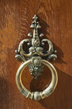 Coppery wrought door knocker Stock Images