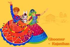 Coppia l'esecuzione della danza popolare di ghodi di Kachhi del Ragiastan, India Immagine Stock