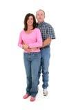 Coppie casuali che si levano in piedi insieme sopra il bianco Fotografia Stock