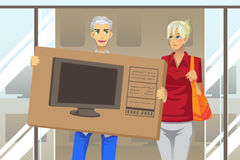 Coppie che comprano TV Immagine Stock