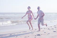 Coppie che corrono insieme Fotografia Stock