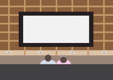 Coppie che guardano TV Immagini Stock