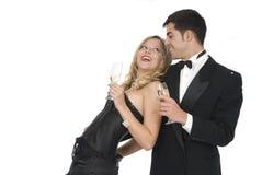 Coppie che ridono nella celebrazione di nuovo anno Fotografia Stock