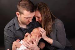 Coppie con il bambino appena nato Fotografia Stock