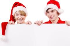 Coppie con il bordo vuoto in bianco dell'insegna Natale Immagine Stock