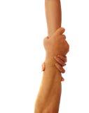 Coppie con il salvataggio delle mani Fotografie Stock