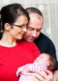 Coppie con la neonata Immagine Stock