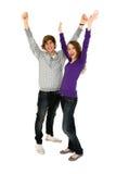 Coppie con le braccia alzate Fotografia Stock Libera da Diritti