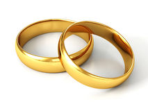 Coppie degli anelli di cerimonia nuziale dell'oro su priorità bassa bianca Immagine Stock