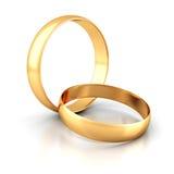 Coppie degli anelli di cerimonia nuziale dell'oro su priorità bassa bianca Fotografie Stock
