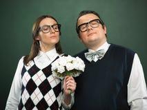 Coppie dei nerd nell'amore fotografia stock libera da diritti