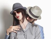 Coppie del gangster con la donna di ribaltamento Fotografie Stock