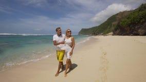Coppie della famiglia sulla spiaggia Fotografie Stock Libere da Diritti