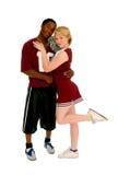 Coppie della ragazza pon pon e del giocatore di football americano Immagine Stock