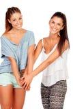Coppie delle amiche con le mani insieme Fotografia Stock