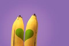 Coppie delle banane e del cuore verde Immagini Stock