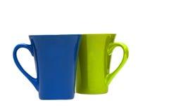 Coppie delle tazze isolate su priorità bassa bianca Immagine Stock Libera da Diritti