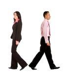Coppie di affari che camminano via Immagini Stock Libere da Diritti