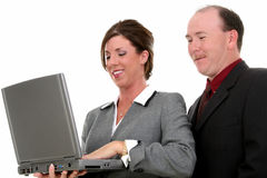 Coppie di affari con il computer portatile Fotografia Stock