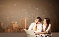 Coppie di affari con le costruzioni e le misure Immagine Stock