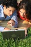 Coppie di affari del computer portatile Fotografia Stock