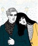 Coppie di giovani amanti in precipitazioni nevose immagini stock
