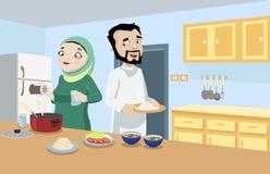 Coppie di Khaliji nella cucina Immagine Stock