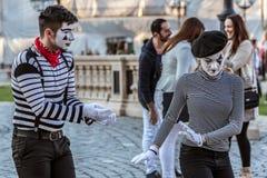 Coppie di pantomimo con il fronte dipinto Fotografia Stock