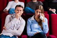 Coppie e l'altra gente in cinematografo Fotografie Stock Libere da Diritti