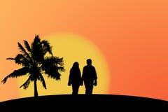 Coppie e tramonto Fotografia Stock