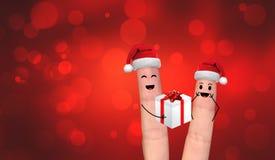 Coppie felici del dito nell'amore che celebra natale Fotografie Stock Libere da Diritti