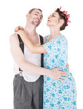 Coppie felici divertenti della famiglia isolate Fotografia Stock