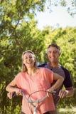 Coppie felici su un giro della bici Immagine Stock Libera da Diritti