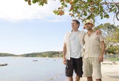Coppie gaie sulla vacanza Immagini Stock Libere da Diritti