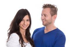 Coppie isolate giovani felici nell'amore. Fotografia Stock