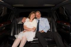 Coppie in limousine Fotografia Stock Libera da Diritti