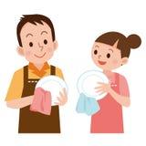 Coppie per pulire i piatti Immagini Stock