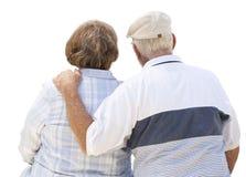 Coppie senior pensionate da dietro su bianco fotografia stock