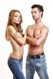 Coppie sexy che propongono sulla priorità bassa bianca Immagini Stock