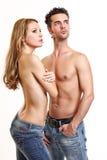 Coppie sexy che propongono sulla priorità bassa bianca Fotografia Stock