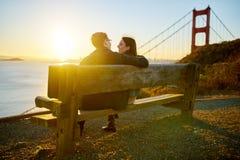 Coppie sul banco, Golden Gate Park, San Francisco Immagine Stock Libera da Diritti