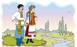 Coppie ucraine in costumi nazionali variopinti Fotografie Stock Libere da Diritti